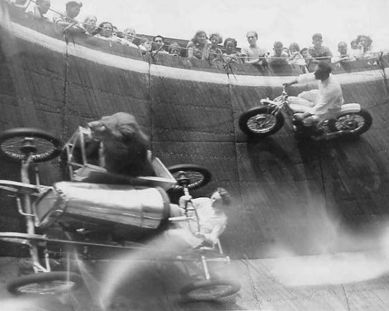 Yes... That IS a live lion in a box on the side of that car going around a Wall of Death.